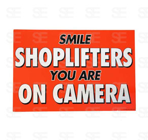6 X 9 SIGN / SMILE SHOPLIFTERS